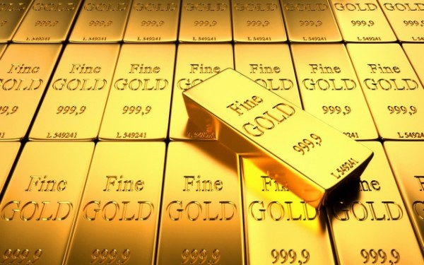 Аккуратно сложенные слитки золота