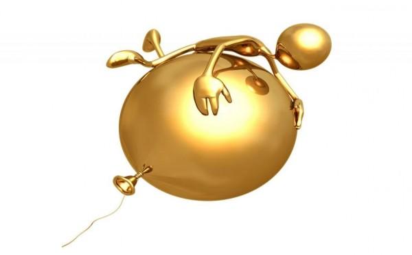Силуэт человека сверху на шаре, выполненные в золотом цвете на белом фоне