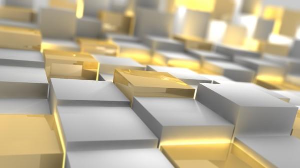 Золотые и серебряные слитки крупным планом