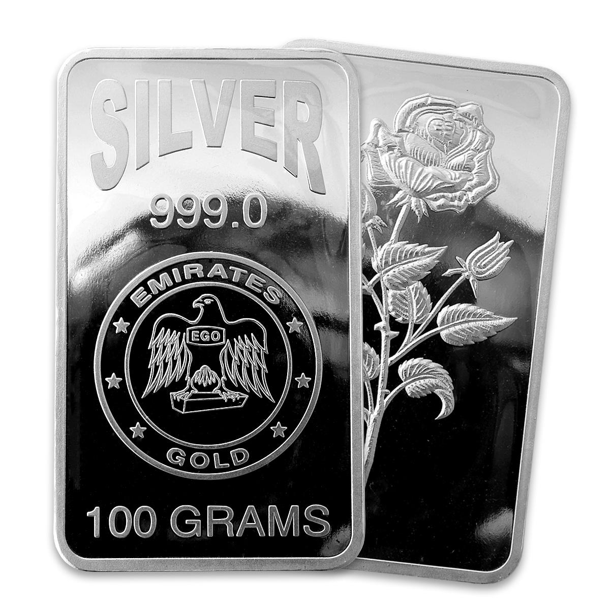 2 серебряных слитка на белом фоне