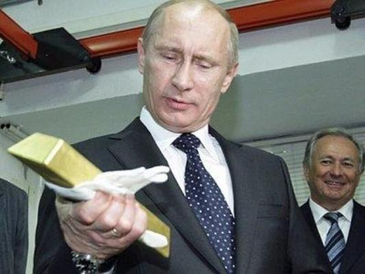 В. В. Путин со слитком золота в руках