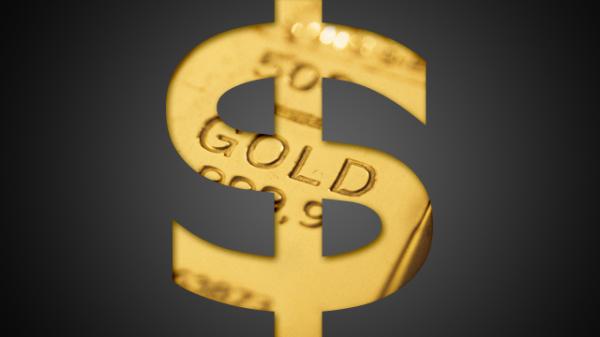 Золотой значок доллара США на чёрном фоне