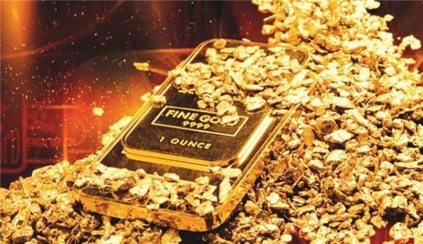 Курс золота: золотой слиток в золотых крошках