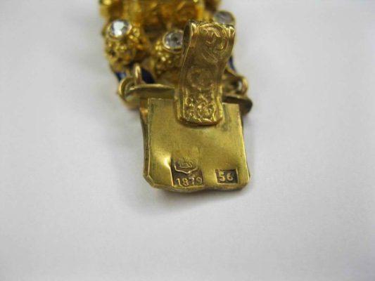 золотое изделие 56 пробы с плетеным узором