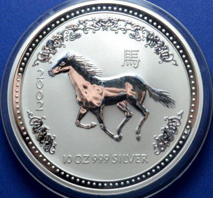 монета из серебра 999 пробы 2002 года