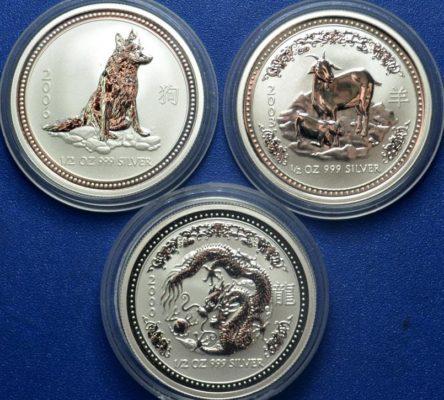 разные серебряные монеты 999 пробы