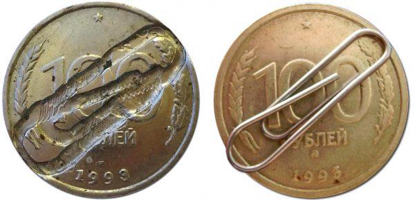 залипание скрепки между штемпелями на монете
