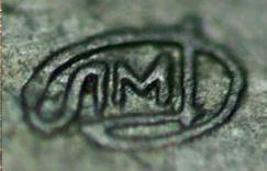 монограмма ЛМ на монете